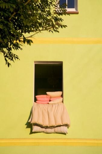 Duvet「Duvets and pillows airing from a window, Poland」:スマホ壁紙(9)