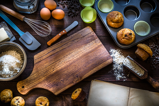 Recipe「Homemade muffins and ingredients to cook on rustic wooden table with copy space」:スマホ壁紙(3)
