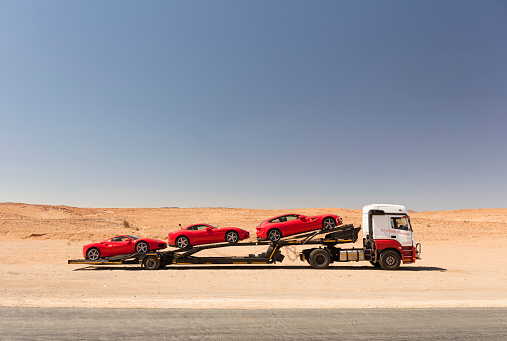 Sports Car「Red sports cars on car carrier in Namibia」:スマホ壁紙(14)