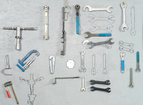 Work Tool「Tools hanging on a wall, close-up」:スマホ壁紙(18)