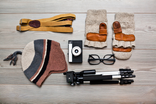 Hobbies「Photographer's equipment and clothing items arranged on floor」:スマホ壁紙(2)