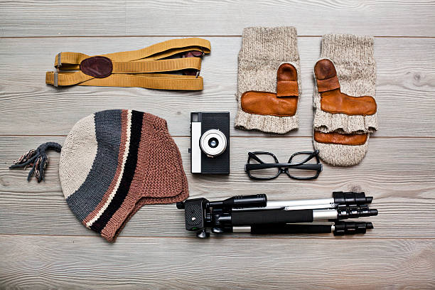 Photographer's equipment and clothing items arranged on floor:スマホ壁紙(壁紙.com)