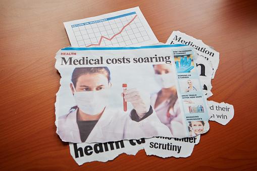 "Protective Glove「Scientists examine blood samples under headline ""Medical costs soaring""」:スマホ壁紙(17)"