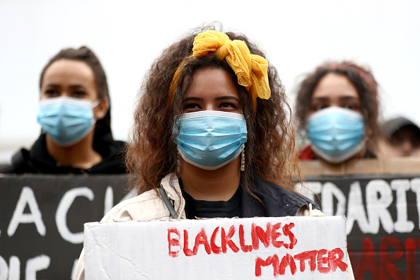 Protestor「Auckland Black Lives Matter Rally Held In Solidarity With U.S. Marches」:写真・画像(6)[壁紙.com]