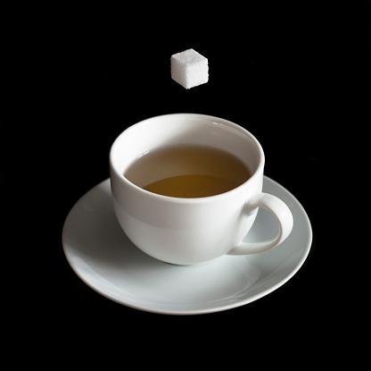 Tea「Sugar Cube Hovering Above Tea Cup, Black Background」:スマホ壁紙(12)
