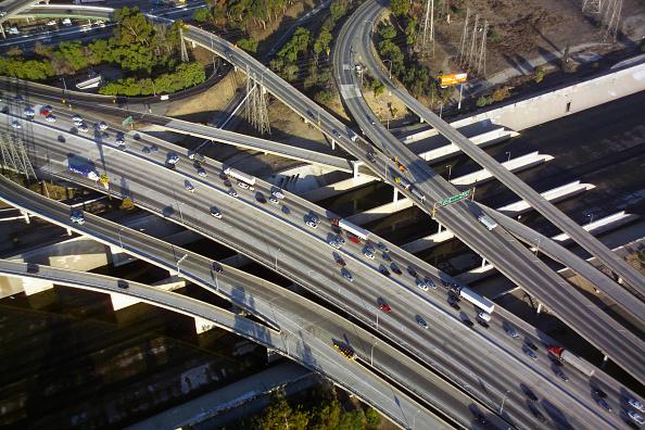Overpass - Road「Los Angeles freeway interchange, California, USA, aerial view, dawn」:写真・画像(0)[壁紙.com]