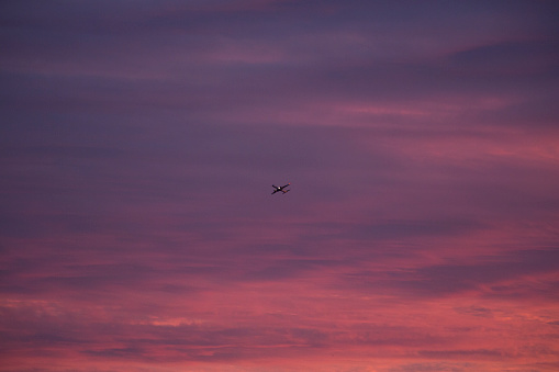 Sunset「An aeroplane takes off into deep red clouds at sunset」:スマホ壁紙(11)