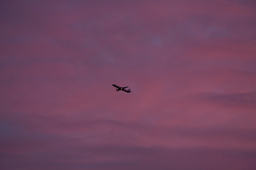Sunset「An aeroplane takes off into deep red clouds at sunset」:スマホ壁紙(12)