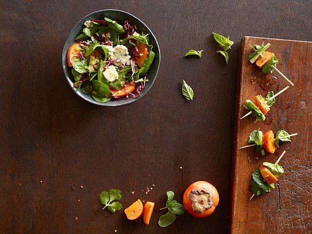 Persimmon salad & skewers on wooden cutting board:スマホ壁紙(壁紙.com)