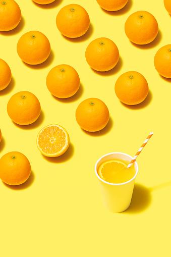 Turkey - Middle East「Orange juice flat lay on yellow background」:スマホ壁紙(9)