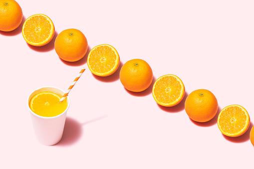 Orange - Fruit「Orange juice flat lay on pink background」:スマホ壁紙(14)