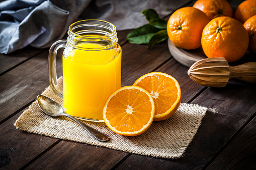 Vegetable Juice「Orange juice glass jar shot on rustic wooden table」:スマホ壁紙(7)