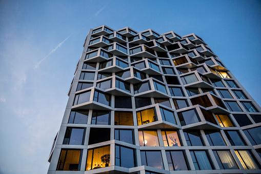 Munich「Modern high-rise residential building in the evening, Munich, Germany」:スマホ壁紙(8)