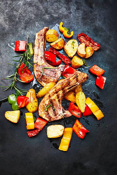 Lamb chops, potatoes and oven vegetables on slate:スマホ壁紙(壁紙.com)