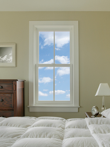 Vertical「View out bedroom window with blue sky and clouds」:スマホ壁紙(2)