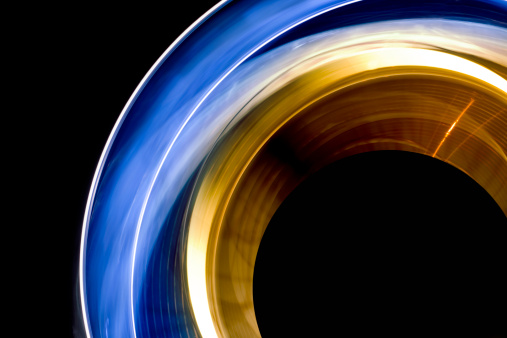 Convex「Long exposure shot of blue and yellow spinning lights」:スマホ壁紙(9)