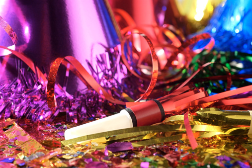 Celebration「Close-up still life of New Year's Eve party favors including hats and noise makers.」:スマホ壁紙(4)