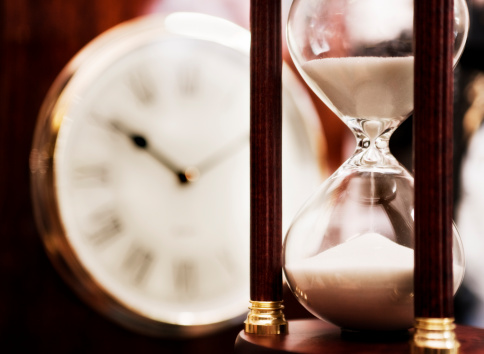 Sepia Toned「Old fashioned hourglass with clock dial in background」:スマホ壁紙(13)
