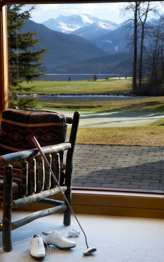 Putting - Golf「Canada, British Columbia, Whistler, golf shoes and putter next beside chair in mountains」:スマホ壁紙(4)