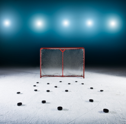 Hockey Puck「Ice hockey goal surrounded by pucks.」:スマホ壁紙(16)