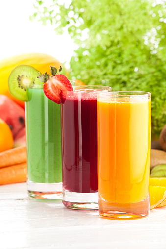 Vegetable Juice「Three glasses of fruit juices on white garden table」:スマホ壁紙(1)