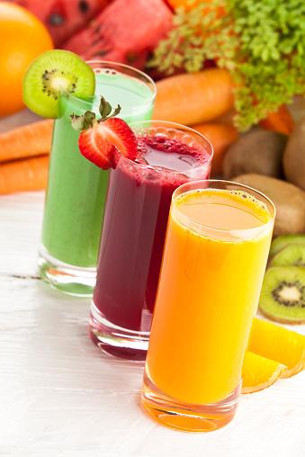 Vegetable Juice「Three glasses of fruit juices and garnish on white table」:スマホ壁紙(13)