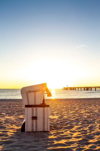 Coastal Feature「Hooded beach chair at the beach against evening sun, Heiligendamm, Germany」:スマホ壁紙(18)