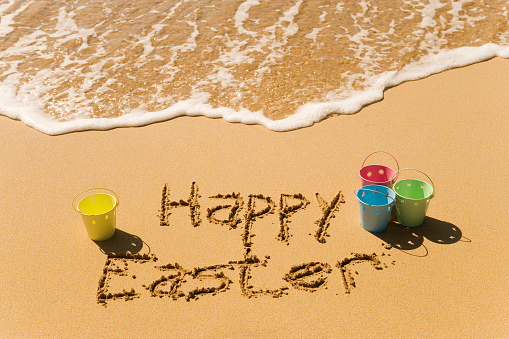 Easter「Happy Easter writing at a beach with buckets on the sides」:スマホ壁紙(15)