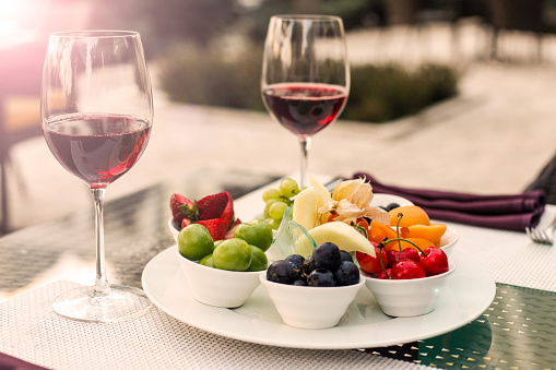 Mediterranean Food「Summer Fruits and Wine Bottle on a table at sunset」:スマホ壁紙(2)