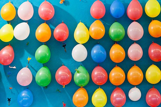 Germany, Bavaria, Munich, Multi coloured balloons and dart at oktoberfest:スマホ壁紙(壁紙.com)