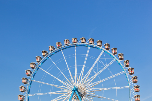 お祭り「Germany, Bavaria, Munich, View of part of ferris wheel against clear sky」:スマホ壁紙(8)