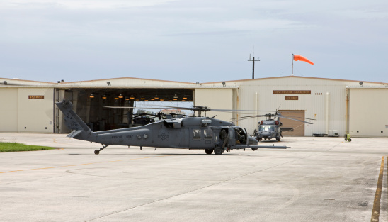 Unrecognizable Person「Two HH-60G Pave Hawk helicopters from the 33rd Rescue Squadron prepare to take off on a training mission at Kadena Air Base, Okinawa, Japan.」:スマホ壁紙(5)