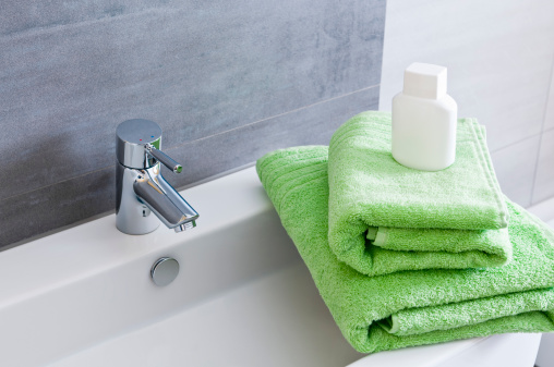 Towel「Rectangular bathroom sink with one green and one orange towel」:スマホ壁紙(14)