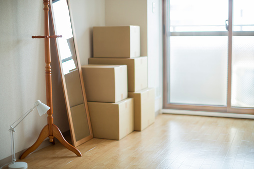 Desk Lamp「Stack of moving boxes and furniture in an empty room」:スマホ壁紙(18)