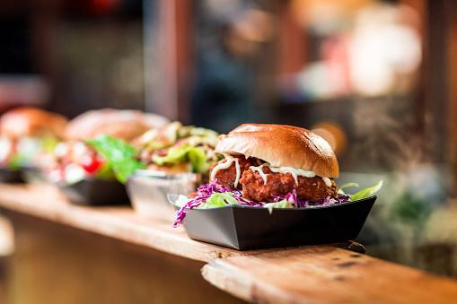 Lunch「Fresh Crispy Pork Burgers in a row at Food Market」:スマホ壁紙(8)