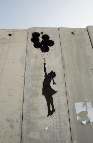 Graffiti「British Guerrilla Artist Decorates West Bank Barrier」:写真・画像(17)[壁紙.com]