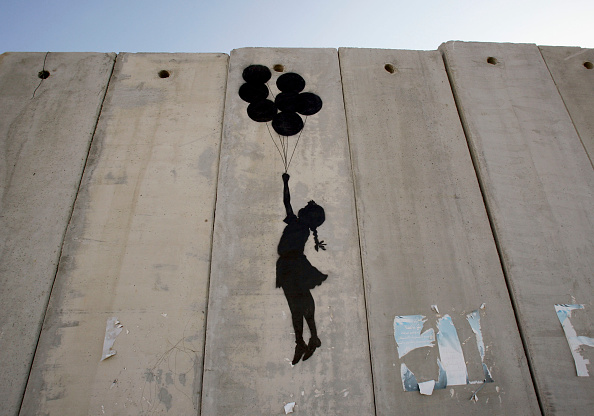 Street Art「British Guerrilla Artist Decorates West Bank Barrier」:写真・画像(9)[壁紙.com]