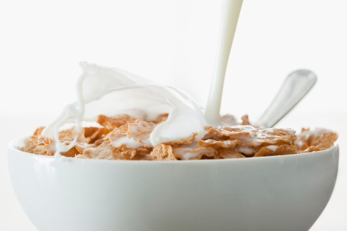Breakfast Cereal「Milk pouring onto cereal in bowl」:スマホ壁紙(15)