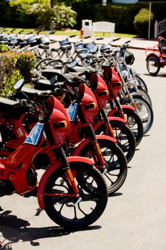 Motorcycle「Side profile of red mopeds parked on a street, San Diego, California, USA」:スマホ壁紙(10)