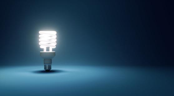 Efficiency「Energy Saver Light Bulb Glowing On Dark Cyan Background」:スマホ壁紙(14)