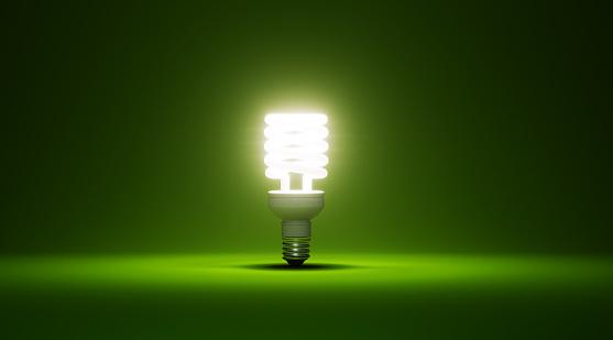 Power Supply「Energy Saver Light Bulb Glowing On Green Background」:スマホ壁紙(2)