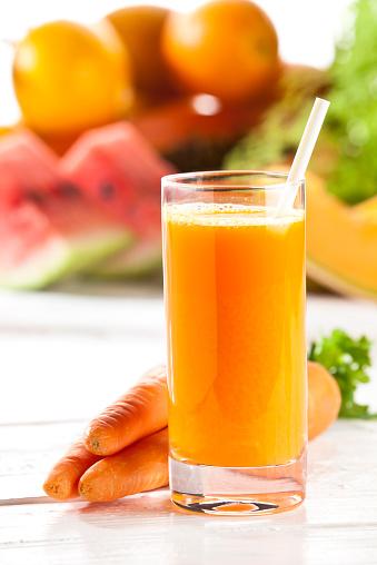 Vegetable Juice「Carrot juice glass on white garden table」:スマホ壁紙(18)