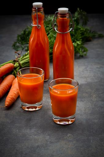Vegetable Juice「Carrot juice in bottles and glasses, bunch of carrots」:スマホ壁紙(6)