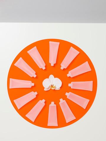 時計「Empty frosted cosmetics bottles in a circle on an orange perspex circle」:スマホ壁紙(13)