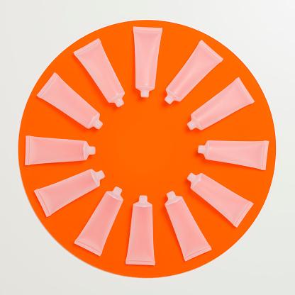 時計「Empty frosted cosmetics bottles in a circle on an orange perspex circle」:スマホ壁紙(14)