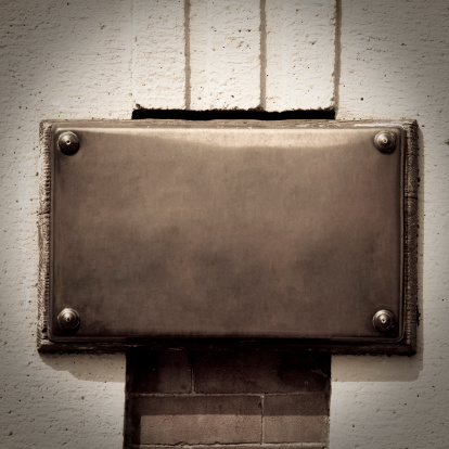 Sepia Toned「Bronze Plaque on a Wall Background with Copy Space」:スマホ壁紙(6)
