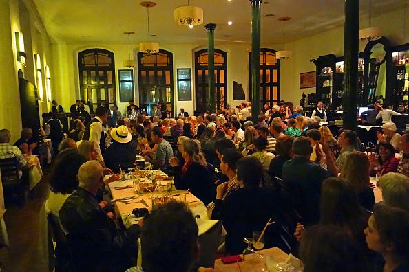 Nightlife「Tourists listening to music in nightclub, Havana」:写真・画像(11)[壁紙.com]
