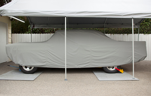 Restoring「Classic automobile restored, under a automobile cover, under a tent, with a wheel clamp in a residential driveway - part of a series」:スマホ壁紙(14)