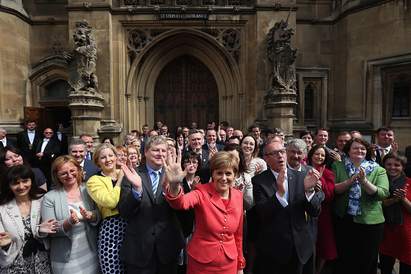 Large Group Of People「SNP MP's Pose In Front Of Parliament Following Election Success」:写真・画像(15)[壁紙.com]