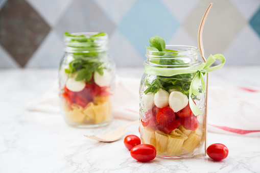 Arugula「Calabrese salad with pasta, tomatoes, mozzarella, rocket and basil in glasses」:スマホ壁紙(0)